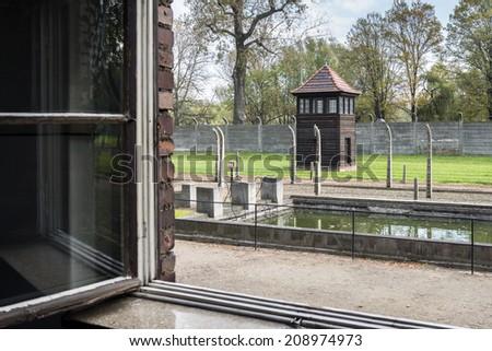 BRZEZINKA, POLAND - OCTOBER 13, 2012: Auschwitz-Birkenau, German Nazi concentration and extermination camp in Poland. Auschwitz was a network of concentration camps built in Poland by Nazi Germany - stock photo