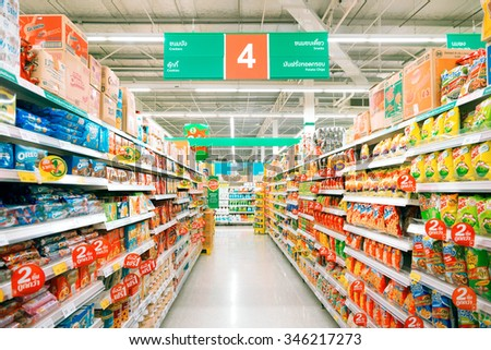 Buayai Nakhonratchasima, 20 DECEMBER 2015: Rows of shelves in Tesco Lotus supermarket in Buayai district, Nakhonratchasima province, Thailand. Tesco Lotus is a largest hypermarket chain in Thailand - stock photo