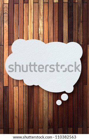 bubble cloud talk tag recycled paper stick on wood background - stock photo