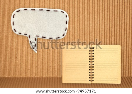 bubble fabric on brown paper with note book - stock photo
