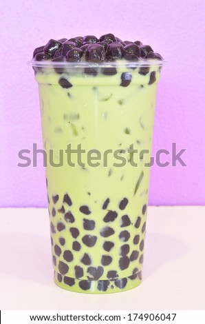 bubble milk green tea in plastic cup - stock photo