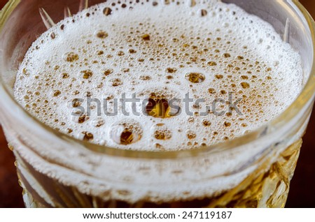 bubbles in glass of fresh lager beer - stock photo