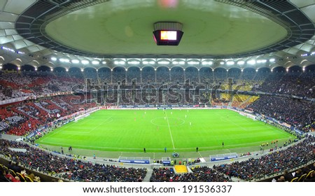 BUCHAREST - APRIL 17: Crowd of football supporters during a match between Dinamo and Steaua Bucharest. On April 17, 2014 in Bucharest, Romania  - stock photo