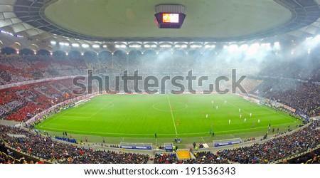 BUCHAREST - APRIL 17: Panorama of National Arena stadium during a match between Dinamo and Steaua Bucharest. On April 17, 2014 in Bucharest, Romania  - stock photo