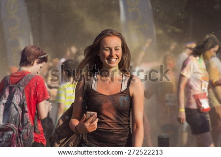 BUCHAREST, ROMANIA - APRIL 25:Crowds of unidentified people at The Color Run on April 25, 2015 in Bucharest, Romania. Color Run is a worldwide hosted fun race with about 1500 competitors in Bucharest. - stock photo