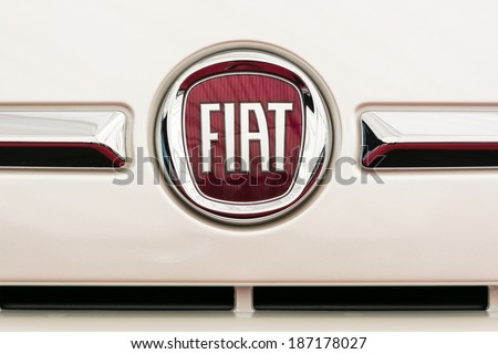 BUCHAREST, ROMANIA - APRIL 04, 2014: Fiat Sign Close Up. Founded in 1899 in Italy, in 2013 was the second largest European automaker by volumes produced, and the seventh in the world. - stock photo
