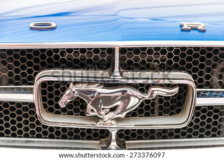 BUCHAREST, ROMANIA - APRIL 25, 2015: Ford Mustang is an automobile manufactured by the Ford Motor Company and was introduced on April 17, 1964. - stock photo