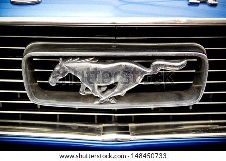 BUCHAREST, ROMANIA - APRIL 04: Ford Mustang Sign on April 04, 2012 in Bucharest, Romania. The Ford Mustang is an automobile manufactured by the Ford Motor Company and was introduced on April 17, 1964. - stock photo