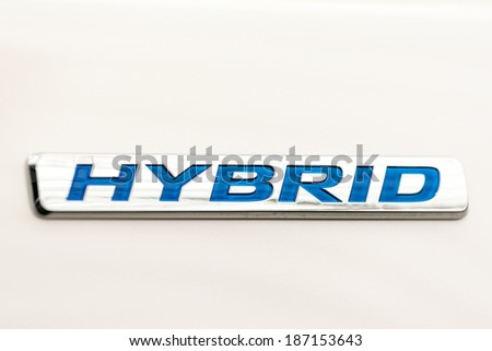 BUCHAREST, ROMANIA - APRIL 04, 2014: Honda Jazz Hybrid Engine Sign Close Up. Honda is one of the first car manufacturers that launches a hybrid vehicle in 2014. - stock photo