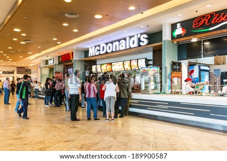 BUCHAREST, ROMANIA - APRIL 21: People buying fast-food from McDonald's Restaurant on April 21, 2014 in Bucharest, Romania. McDonald's is the main fast-food restaurant chain in Romania. - stock photo