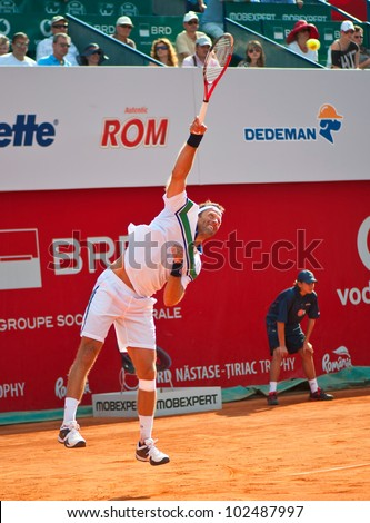 BUCHAREST, ROMANIA - APRIL  28: Tennis player Robert Lindstedt (SWE) in action during BRD Nastase Tiriac Trophy on April  28, 2012 in Bucharest, Romania - stock photo