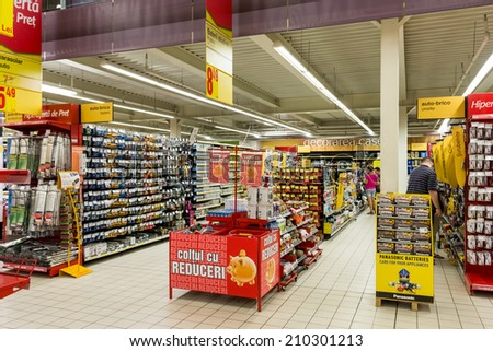 BUCHAREST, ROMANIA - AUGUST 10, 2014: Electronic Products For Sale In Supermarket Aisle. - stock photo