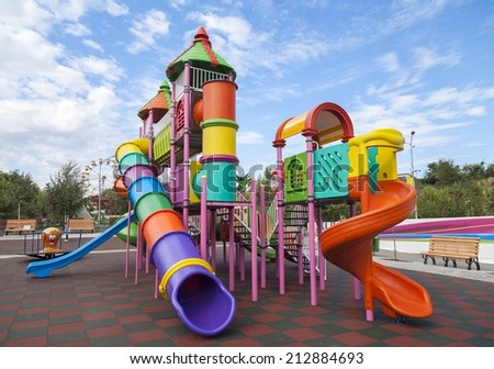 BUCHAREST, ROMANIA - AUGUST 25, 2014: Playground for children in one of the largest parks in Bucharest - stock photo