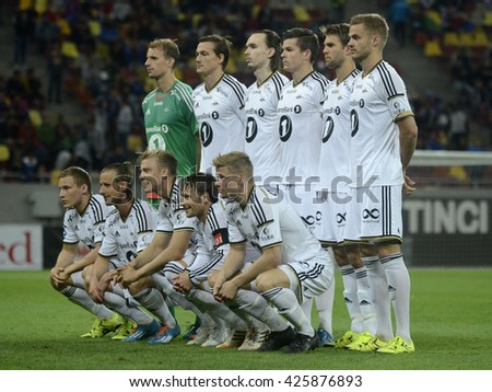 BUCHAREST, ROMANIA - AUGUST 20, 2015: Rosenborg BK line up pictured prior to the Europa League game between FC Steaua Bucharest and Rosenborg BK at National Arena. Rosenborg won, 3-0. - stock photo