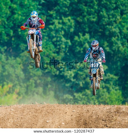 BUCHAREST, ROMANIA - AUGUST 25: unidentified riders participate in the Fourth National Endurocross Championship on AUGUST 25, 2012 at Dragomiresti Deal in Bucharest, Romania - stock photo