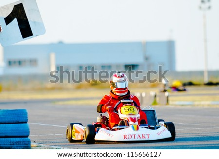 BUCHAREST, ROMANIA - AUGUST 4: Unknown pilot competing in National Karting Championship 2012 at Amkart Bucharest, on August 4, in Bucharest, Romania - stock photo