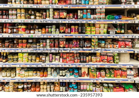 BUCHAREST, ROMANIA - DECEMBER 06, 2014: Canned Food And Special Sauces On Supermarket Stand. - stock photo