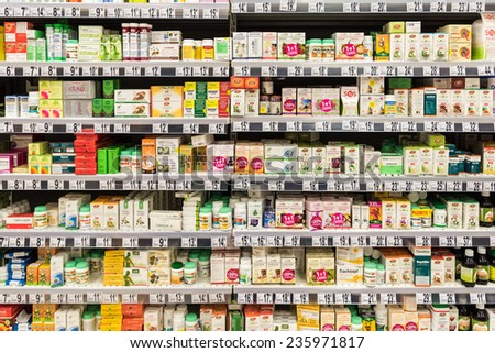 BUCHAREST, ROMANIA - DECEMBER 06, 2014: Medical Pills And Supplements On Pharmacy Stand. - stock photo