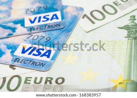 BUCHAREST, ROMANIA - DECEMBER 22, 2013: Visa Credit Cards Over European Union Official Euro Banknotes - stock photo