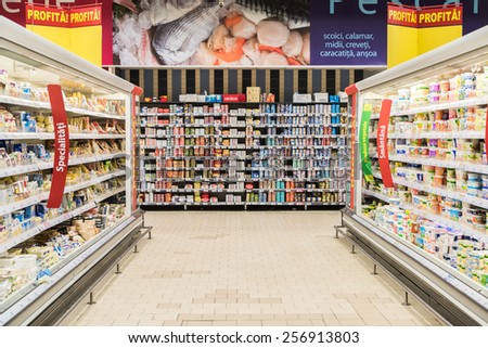 BUCHAREST, ROMANIA - FEBRUARY 25, 2015: Supermarket Food In Refrigerators On Store Aisle. - stock photo