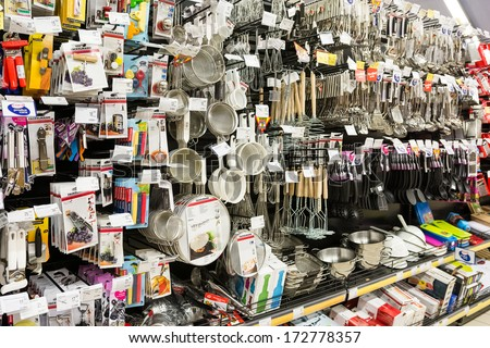 BUCHAREST, ROMANIA - JANUARY 22, 2014: Kitchen Utensils On Supermarket Shelf On January 22, 2014 In Bucharest, Romania. Kitchen utensil are hand-held tools that are used in food preparing. - stock photo