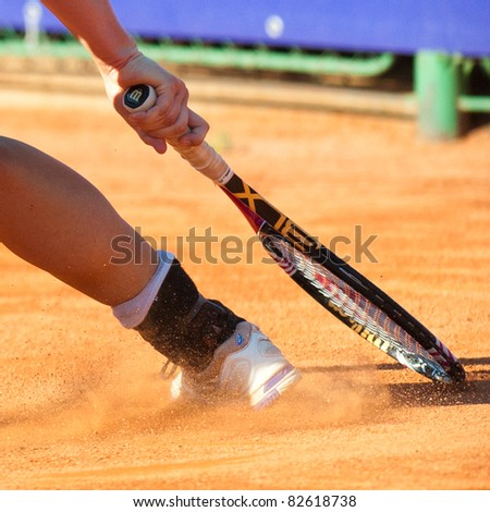 BUCHAREST, ROMANIA - JULY 19: Detail of a tennis player leg in action during BCR Open Ladies on July 19, 2011 in Bucharest, Romania - stock photo