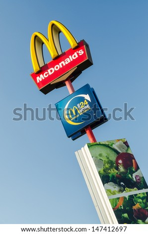 BUCHAREST, ROMANIA - JULY 23: McDonald's Sign on July 23, 2013 in Bucharest, Romania. McDonald's Corporation is the world's largest chain of fast food restaurants. - stock photo