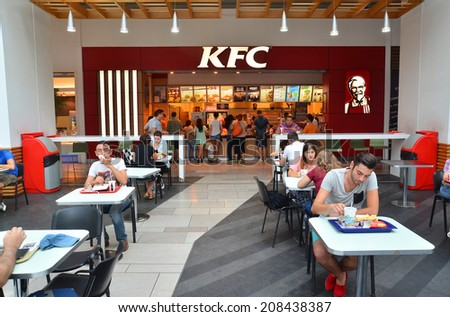 Bucharest, Romania, July 29th: People at the KFC restaurant in Bucharest, Romania. Shot taken on July 29th 2014 - stock photo