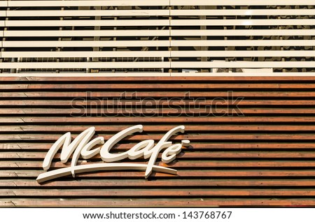 BUCHAREST, ROMANIA - JUNE 25: McDonald's McCafe Sign on June 25, 2013 in Bucharest, Romania. McCafe is a coffee-house-style food and drink chain, owned by McDonald's launched in Melbourne in 1993. - stock photo