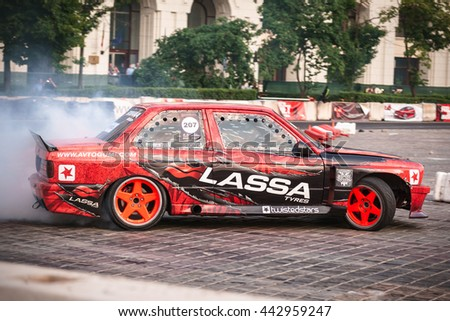 Bucharest, Romania-JUNE 25, 2016:Unknown rider overcomes the track in the National Drift Championship on June 25,2015 in Bucharest, Romania  - stock photo