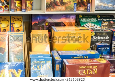 BUCHAREST, ROMANIA - MARCH 22, 2015: Children Board Games For Sale On Library Shelf. - stock photo