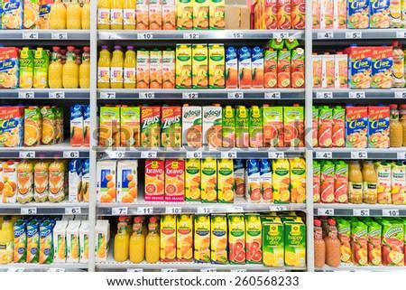 BUCHAREST, ROMANIA - MARCH 15, 2015: Juice Bottles On Supermarket Stand. - stock photo