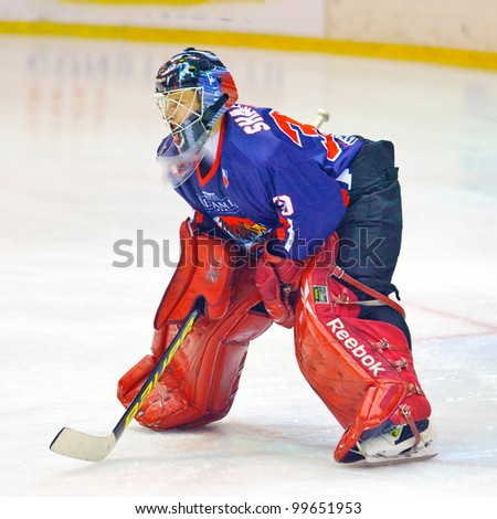 BUCHAREST, ROMANIA - MARCH 11: Unidentified hockey player compete during the Steaua Rangers (blue) vs Corona Brasov (white) at Flamaropol Stadium, score 6-3, on March 11 , 2012 in Bucharest, Romania - stock photo