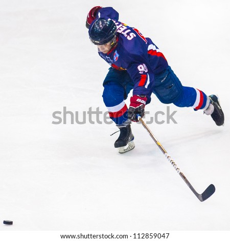 BUCHAREST, ROMANIA - MARCH 11: Unidentified hockey players compete during the Steaua Rangers(blue) vs Corona Brasov(white) game Flamaropol Stadium, score 6-3, on March 11 , 2012 in Bucharest, Romania - stock photo