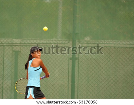 "BUCHAREST, ROMANIA-MAY 16: Australian Naomi Tran is playing during the second day of qualifications for the F1 Romanian Tennis Futures at ""Dinu Pescariu Club"" on May 16, 2010 in Bucharest, Romania. - stock photo"