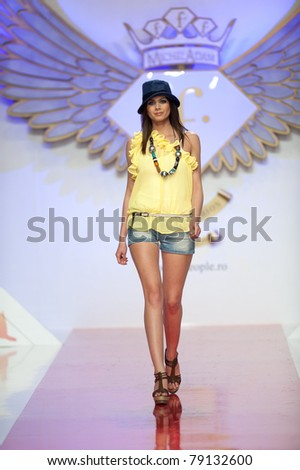 BUCHAREST, ROMANIA - MAY 7: Fashion model wears clothes from BSB collection, in Bucharest Fashion Week at World Trade Center on May 7, 2011, Bucharest, Romania - stock photo