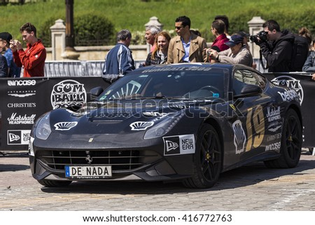 BUCHAREST, ROMANIA - MAY 7: Ferrari F12 on display in Constitution Square on May 7, 2016 in Bucharest. The car is part of the Gumball 3000 Dublin to Bucharest Charity Grid Rally. - stock photo