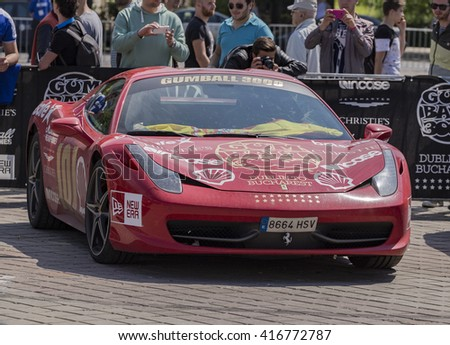 BUCHAREST, ROMANIA - MAY 7: Ferrari 458 on display in Constitution Square on May 7, 2016 in Bucharest. The car is part of the Gumball 3000 Dublin to Bucharest Charity Grid Rally. - stock photo