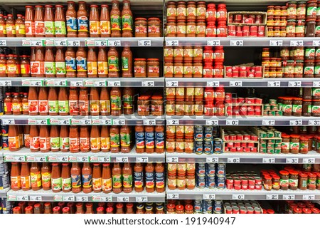 BUCHAREST, ROMANIA - MAY 08: Ketchup Tomato Sauce Bottles On Supermarket Shelf on May 08, 2014 in Bucharest, Romania. - stock photo
