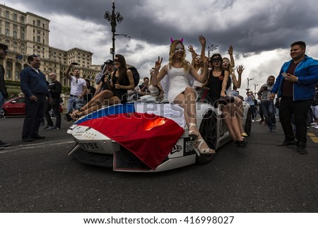 BUCHAREST, ROMANIA - MAY 7: Lamborghini and beautiful girls on parade on May 7, 2016 in Bucharest. The car is part of the Gumball 3000 Dublin to Bucharest Charity Grid Rally. - stock photo