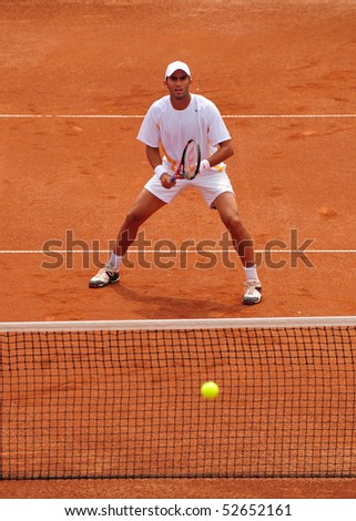 BUCHAREST, ROMANIA MAY 8: Romania's Horia Tecau waits to return the ball during the Davis Cup meeting between Romania and Ukraine at the BNR Arenas on May 8, 2010 in Bucharest, Romania. - stock photo