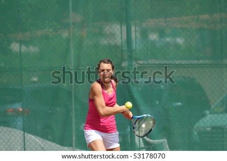 "BUCHAREST, ROMANIA - MAY 16: Romanian Patricia Tig is playing during the second day of qualifications for the F1 Romanian Tennis Futures at ""Dinu Pescariu Club"" on May 16, 2010 in Bucharest, Romania. - stock photo"