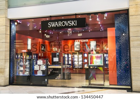 BUCHAREST, ROMANIA - MAY 25: Swarovski store on May 25, 2012 in Bucharest, Romania. The Swarovski Crystal range includes home decoration objects, jewelry and couture, and chandeliers. - stock photo