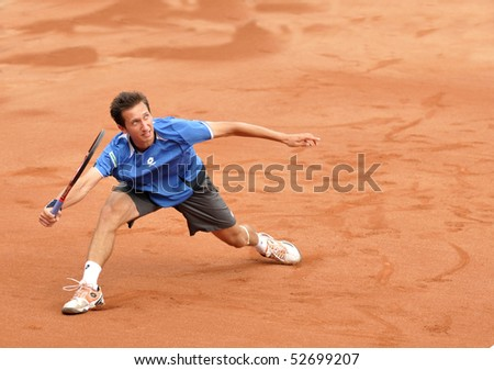 BUCHAREST, ROMANIA - MAY 9: Ukraine's Sergiy Stakhovsky is running for a forehand hit during the forth match of the Davis Cup meeting between Romania and Ukraine at the BNR Arenas on May 9, 2010 in Bucharest, Romania. - stock photo