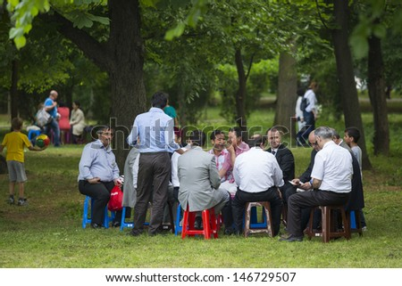 BUCHAREST, ROMANIA - MAY 17: Unidentified group of people  gather, relax and socialize in the park during the celebratory event Turkish Festival on May 17, 2013 in Bucharest, Romania. - stock photo