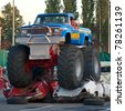 BUCHAREST, ROMANIA - MAY 29: Unknown driver entertains the crowds in his monster truck at ''Stunt Cars Show'' on May 29, 2011 in Bucharest, Romania - stock photo