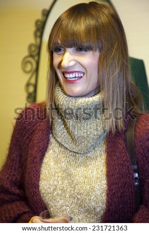BUCHAREST, ROMANIA - NOV 19, 2014: Carmen Negoita arrives at the Opening of the first clothing store Isabel Garcia in Bucharest, Romania on November 19, 2014. - stock photo
