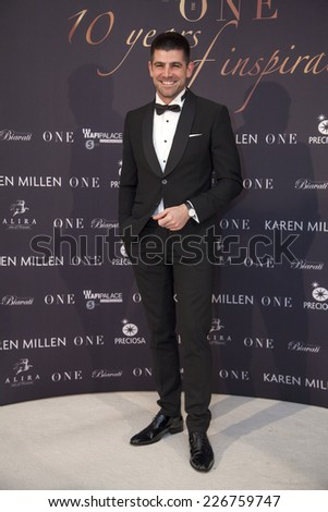 """BUCHAREST, ROMANIA - OCT 27, 2014:  Romanian communication strategist and coach, Dragos Bucurenci arrives at """"Gala The One"""", 10 years of inspiration on October 27, 2014 in Bucharest, Romania. - stock photo"""
