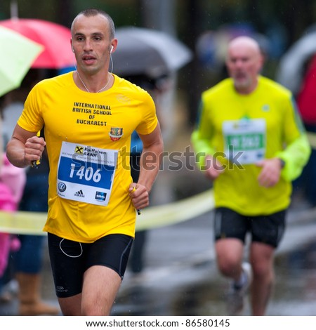 BUCHAREST, ROMANIA - OCTOBER 8: An unidentified marathon runner competes at the Bucharest International Marathon 2011, October 8, 2011 in Bucharest, Romania - stock photo