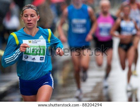 BUCHAREST, ROMANIA - OCTOBER 8: An unidentified marathon runner competes at the Bucharest International Marathon 2011, October 8, 2011 in Bucharest, Romania - stock photo